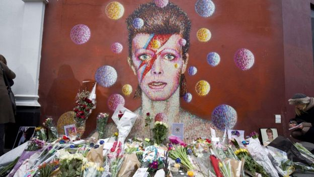 Flowers have been left in tribute to Bowie at a mural in his birthplace of Brixton, south London, painted by street artist James Cochran, aka Jimmy C